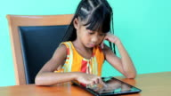 Asian Girl Playing Games On Digital Tablet video