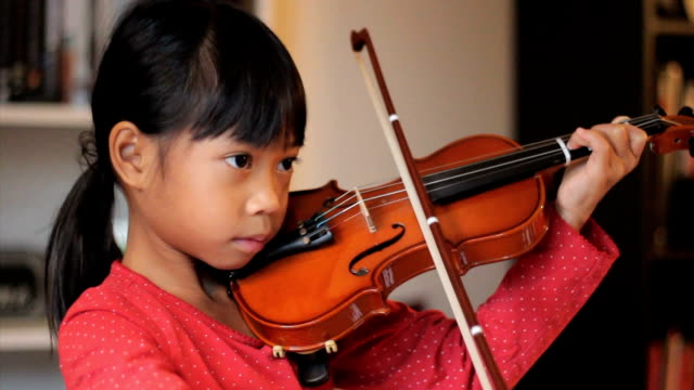Asian Girl Practices Her Violin video