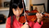 Asian Girl Practices Her Violin-High Angle video