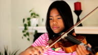 Asian Girl Practicing Violin video