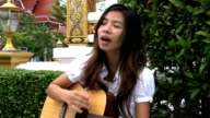 Asian Girl Singing And Playing Guitar video