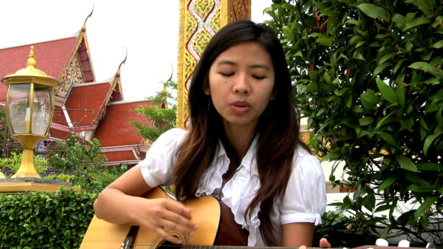 Asian Girl Singing Worship Songs video