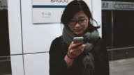 Asian Girl Using a Mobile Phone in Subway station / Beijing, China video
