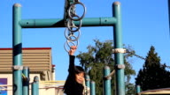 Asian Girl Using Old Style Playground Rings video