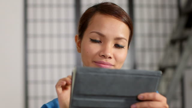 asian girl using touch pad device video