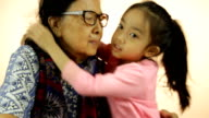 Asian grandmother and granddaughter video