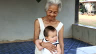 Asian Grandmother with baby video