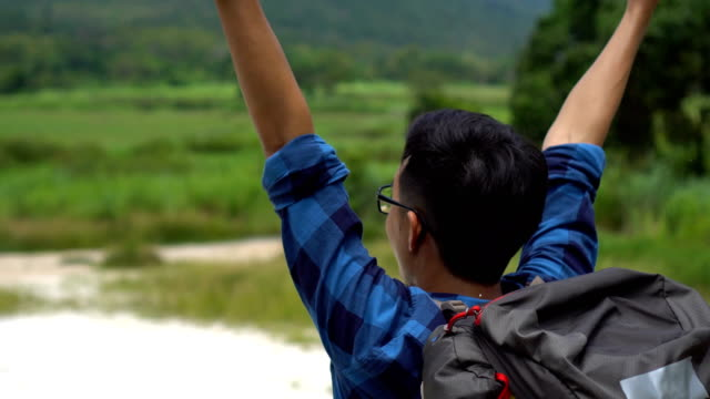 Asian Happy Climber Raising His Arms for his Success video