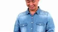 Asian happy man using his smartphone video