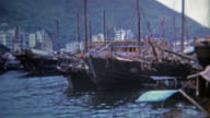 MIKIMOTO, JAPAN 1973: Asian harbor corporate Coke signs invade the native space. video