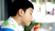 Asian kid enjoy with rainbow ice cream . video