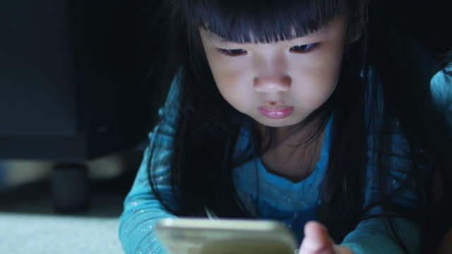 Asian Little Girl Using Smart Phone video