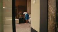 Asian maid cleaning hotel room, woman, people working video