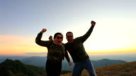 asian man and woman happiness emotion on high mountain ,vacation time video