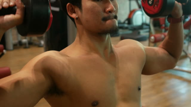 Asian man exercising in Fitness video