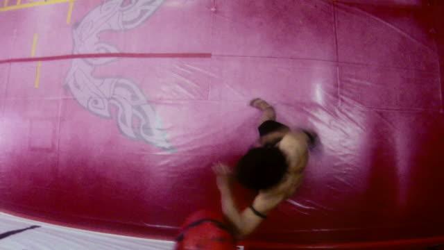 Asian man exercising kickboxing in gym, combat, boxing, sports video
