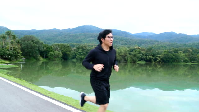 Asian man jogging in the morning video