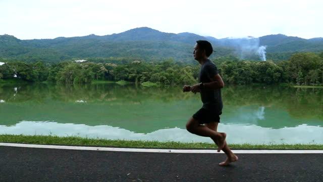 Asian man running on barefoot video