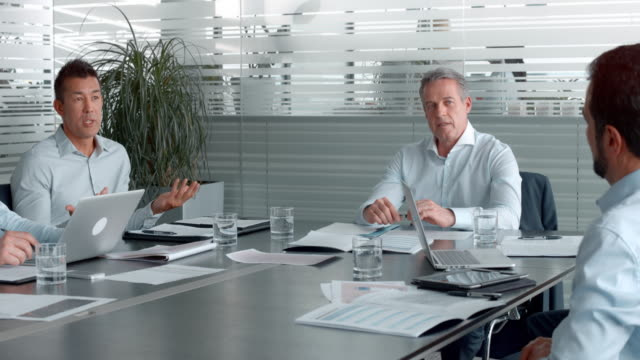 Asian man talking in a meeting with the project manager and colleagues in the conference room video