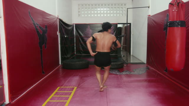 Asian man training kickboxing in gym, fight, martial art, sports video