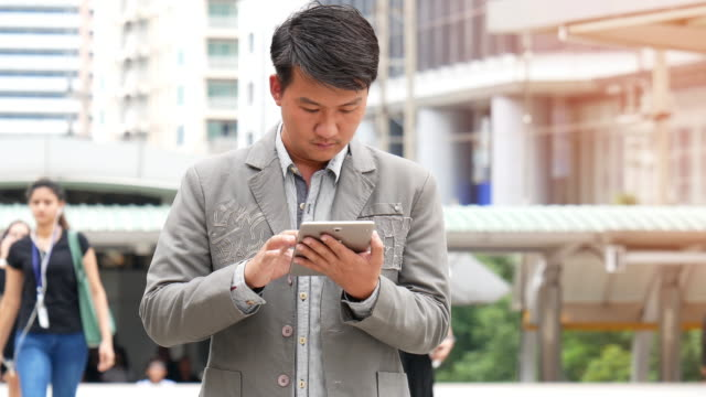 Asian man using a tablet PC video