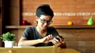Asian man using smart phone or tablet, waiting for someone video