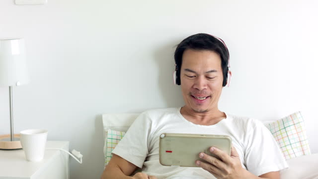 Asian man video chatting video
