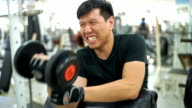 Asian man working out in gym video
