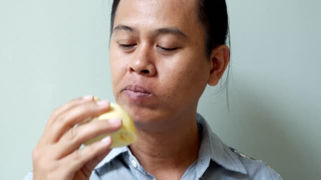 asian men eating durian video