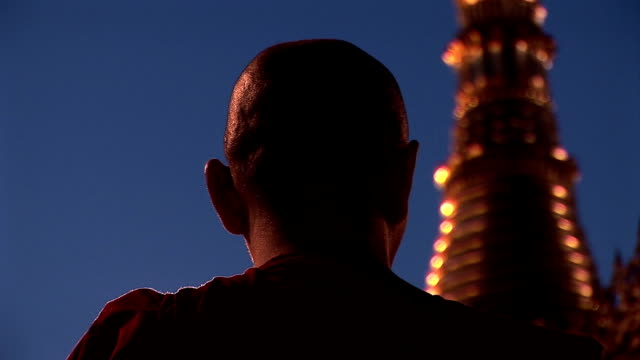 Asian monk praying in pagoda video