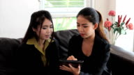 Asian Office Workers Discussing Work On Tablet video