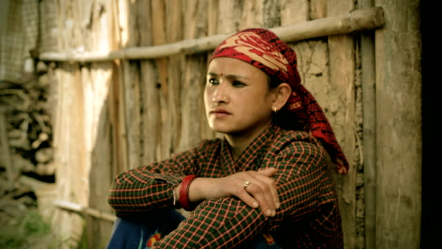 Asian people: Portrait of mature Nepalese women with blank expression. video