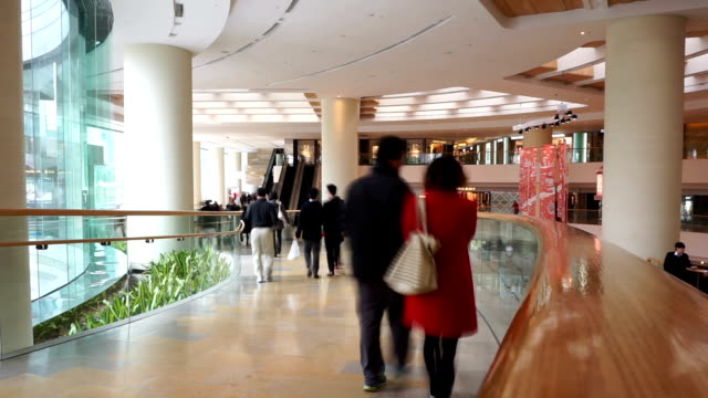 Asian people walking in shopping mall, time lapse. video