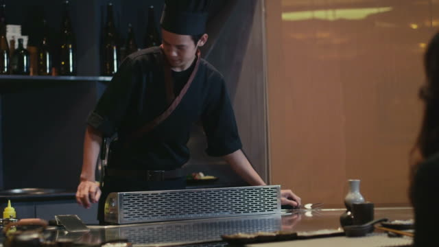 Asian restaurant, young chef cooking food, cook working, client, customer video