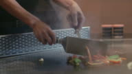 Asian restaurant, young professional chef cooking food, man, cook working video