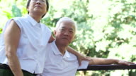 Asian senior couple after retirement cuddle with love video
