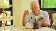 Asian senior man with vintage coffee video