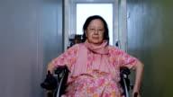Asian senior woman show Thailand's greeting style on wheelchair video