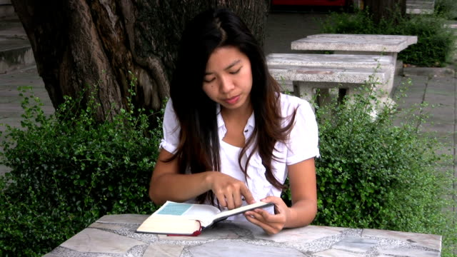 Asian Student Frantically Searching Book video