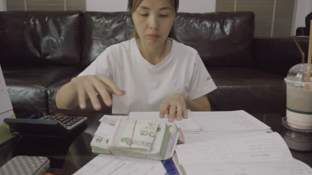 Asian Woman Calculating In Home video