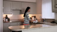 Asian woman cleaning the counters video