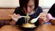 Asian woman eating ramen video