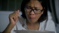 Asian Woman Eating Spicy Thai Green Papaya Salad, Slow motion video