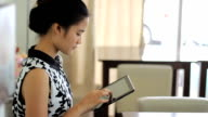Asian Woman Enjoys Drinking Tea In Cafe video