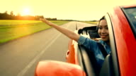 Asian woman experiences freedom on the highway video