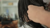 Asian woman haircut in beauty salon video