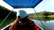 Asian woman is enjoying river view video