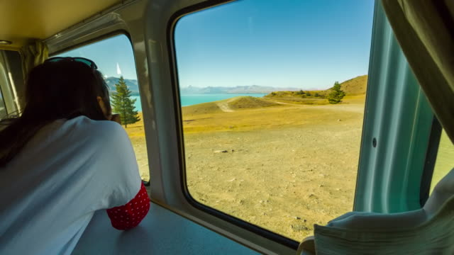 Asian woman looking at the beautiful view of lake Pukaki video