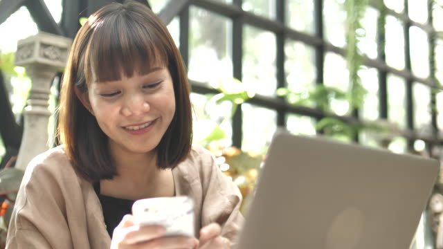 Asian woman Mobile phone use video