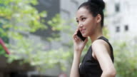 Asian Woman on the Phone video